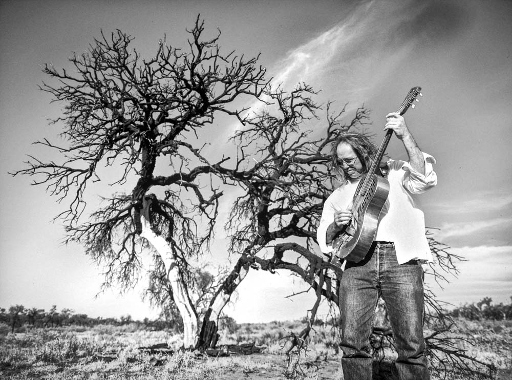 Commercial photography Adelaide. Guitarist Chris Aronsten.